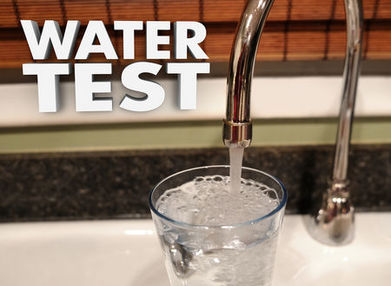 Picture of water faucet filling up a glass of filtered water.